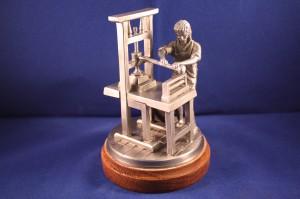 Drucker mit Handdruckerpresse (handgegossen)