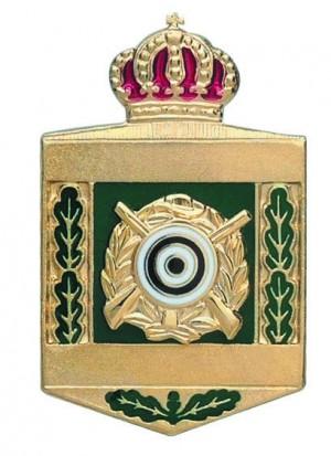 Königsabzeichen vergoldet mit rot hinterlegter Krone