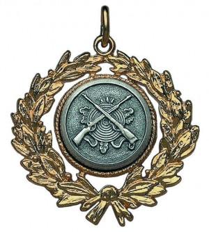 Medaille in antiker Optik mit gekreuzten Gewehren